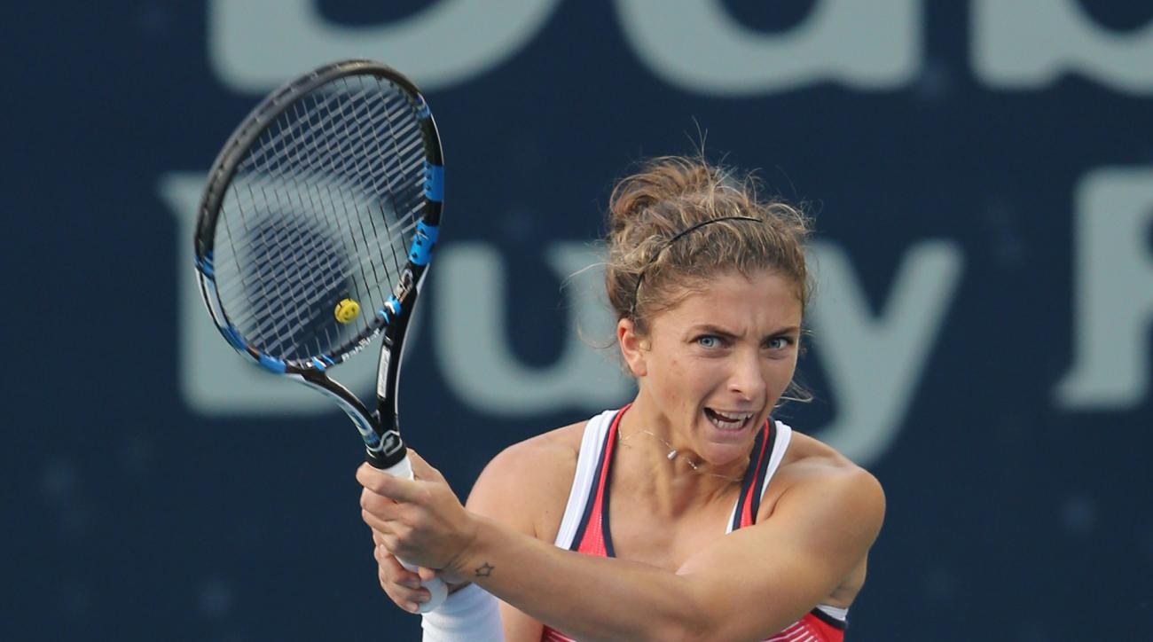 Sara Errani from Italy returns the ball to Saisai  Zheng from China during the second day of the Dubai Tennis Championships in Dubai, United Arab Emirates, Tuesday, Feb. 16, 2016. (AP Photo/Kamran Jebreili)