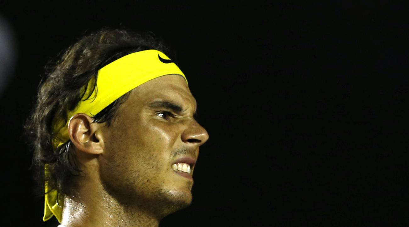 Rafael Nadal of Spain reacts to losing a point in a match against Pablo Carreno of Spain, at the Rio Open tennis tournament, in Rio de Janeiro, Brazil, Tuesday, Feb. 16, 2016. (AP Photo/Silvia Izquierdo)