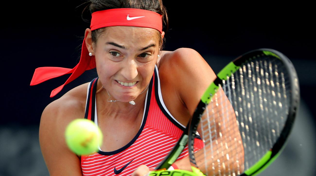 Caroline Garcia of France returns the ball to Carla Suarez Navarro from Spain during the third day of the Dubai Tennis Championships in Dubai, United Arab Emirates, Wednesday, Feb. 17, 2016. (AP Photo/Kamran Jebreili)