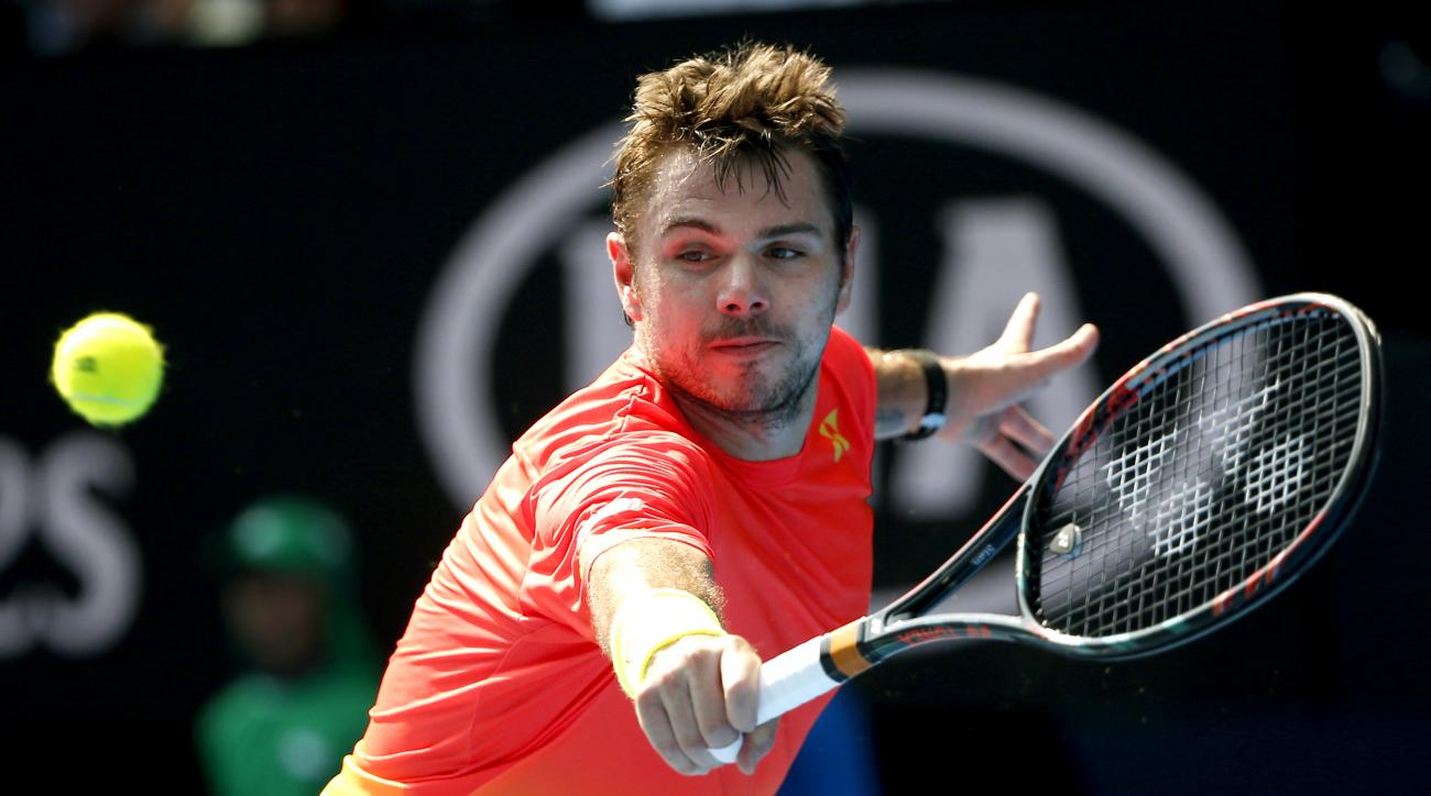 Stan Wawrinka of Switzerland hits a backhand return to Milos Raonic of Canada during their fourth round match at the Australian Open tennis championships in Melbourne, Australia, Monday, Jan. 25, 2016.(AP Photo/Vincent Thian)