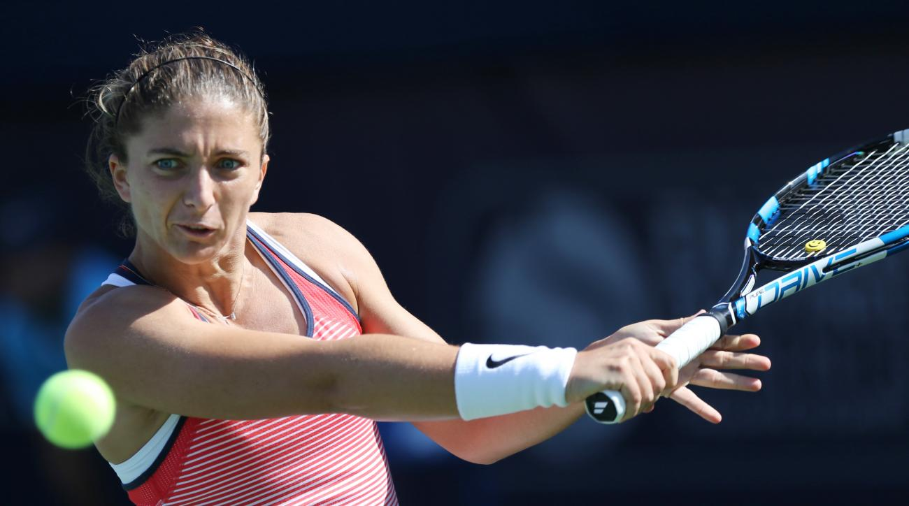Sara Errani from Italy returns the ball to Elina Svitolina of Ukraine during the a semi final match of the Dubai Tennis Championships in Dubai, United Arab Emirates, Friday, Feb. 19, 2016. (AP Photo/Kamran Jebreili)