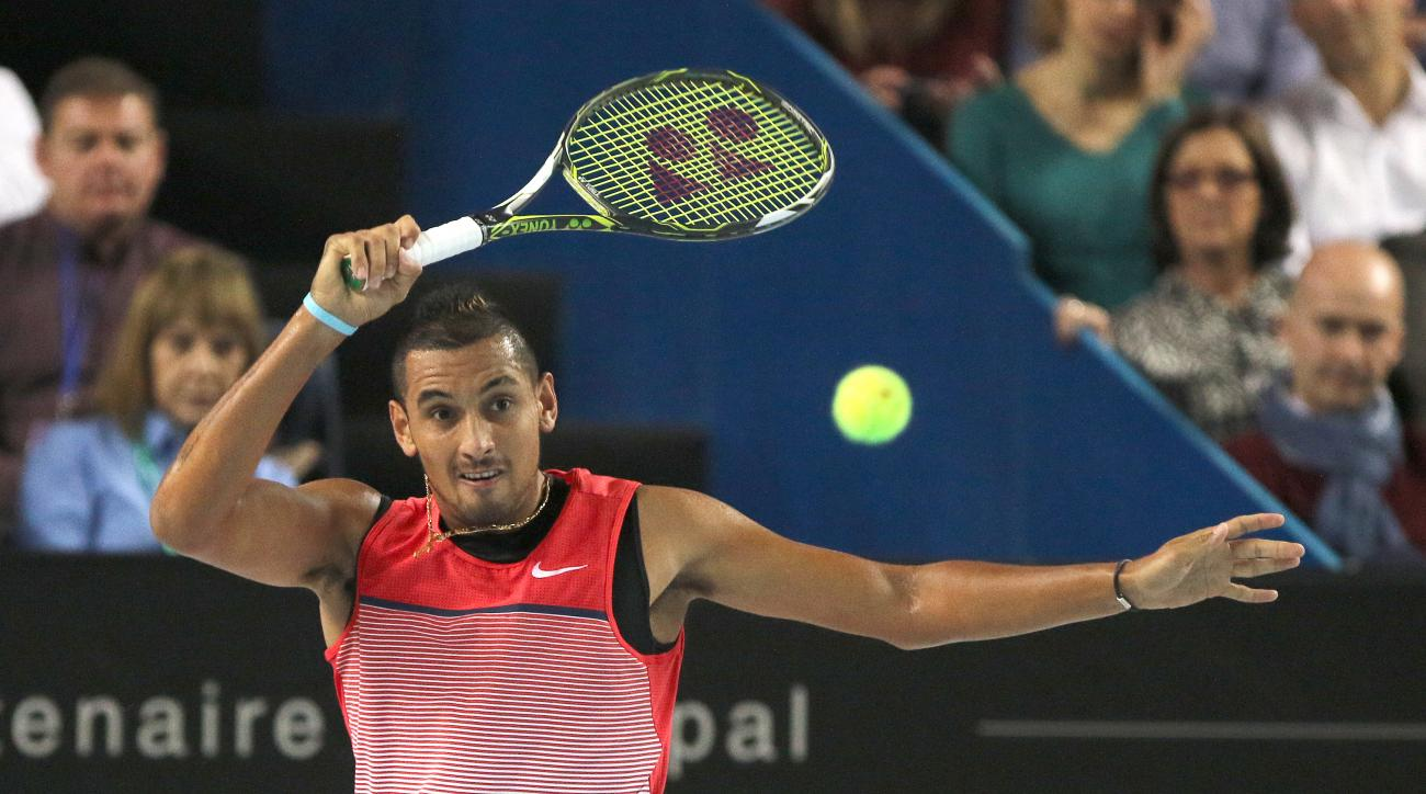 Nick Kyrgios of Australia returns the ball to Marin Cilic of Croatia, during their final match, at the Open 13 Provence tennis tournament, in Marseille, southern France, Sunday Feb. 21, 2016. (AP Photo/Claude Paris)