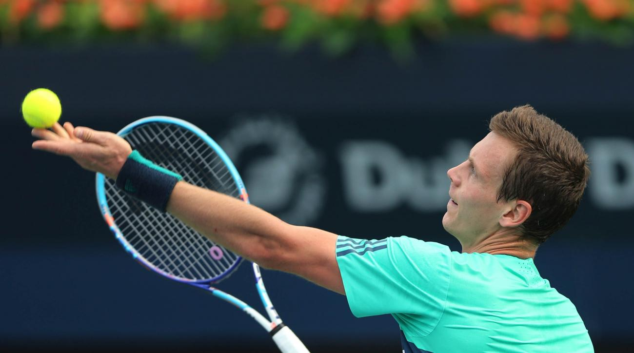 Tomas Berdych of Czech Republic serves the ball to Joao Sousa from Portugal during a second day match of the Dubai Tennis Championships in Dubai, United Arab Emirates, Tuesday, Feb. 23, 2016. (AP Photo/Kamran Jebreili)