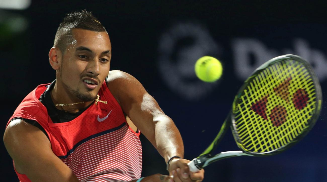 Nick Kyrgios from Australia returns the ball to Martin Klizan from Slovakia during a second day match of the Dubai Tennis Championships in Dubai, United Arab Emirates, Tuesday, Feb. 23, 2016. (AP Photo/Kamran Jebreili)
