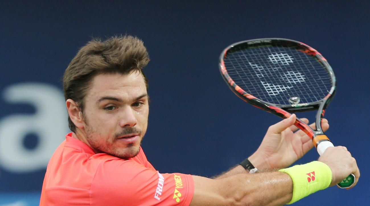 Stan Wawrinka from Switzerland returns the ball to Nick Kyrgios from Australia during a semi final of the Dubai Tennis Championships in Dubai, United Arab Emirates, Friday, Feb. 26, 2016. (AP Photo/Kamran Jebreili)