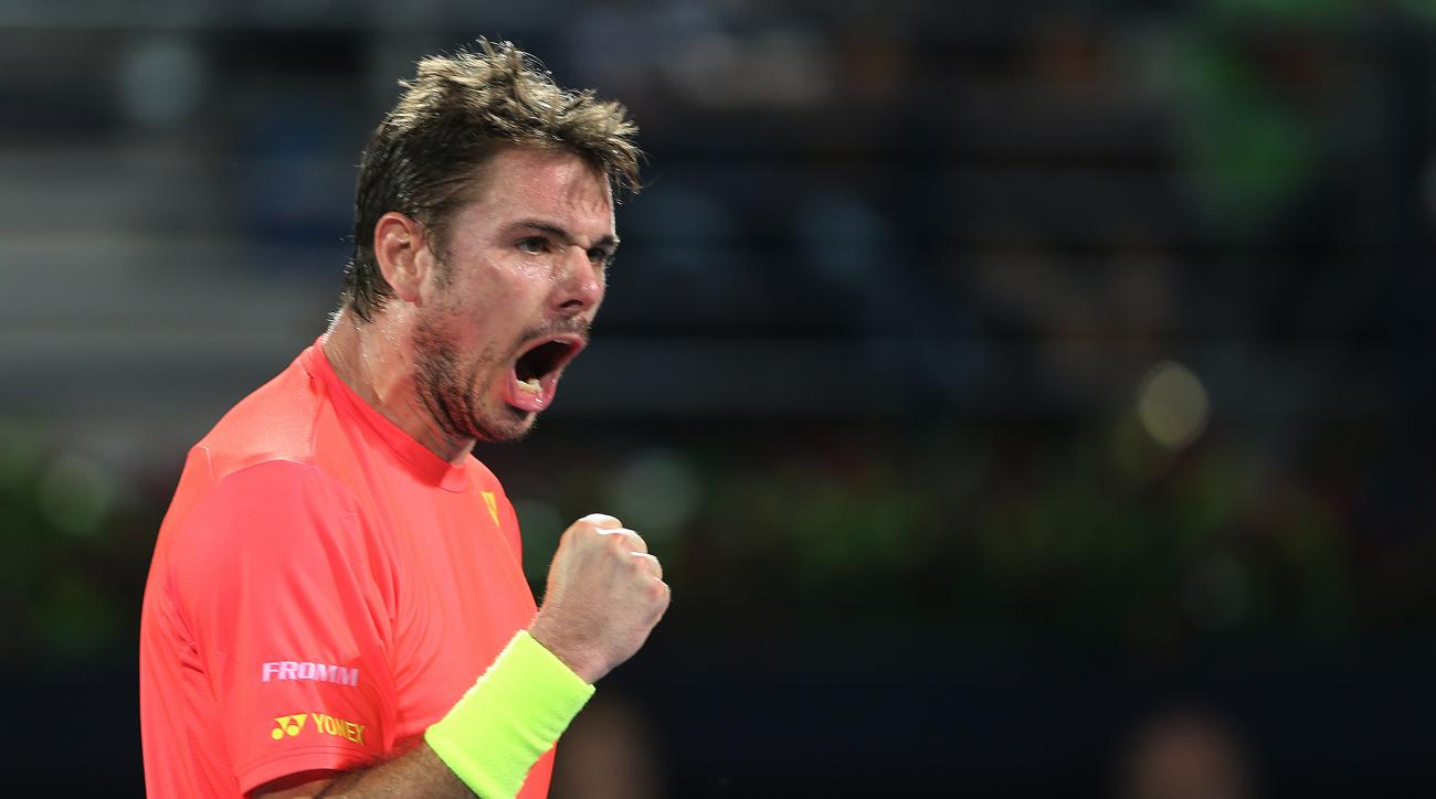 Stan Wawrinka from Switzerland celebrates after he gets a point against Marcos Baghdatis from Cyprus during the final match of the Dubai Tennis Championships in Dubai, United Arab Emirates, Saturday, Feb. 27, 2016. (AP Photo/Kamran Jebreili)