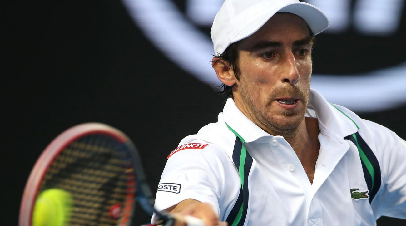 Pablo Cuevas of Uruguay hits a forehand return during his second round match against Nick Kyrgios of Australia at the Australian Open tennis championships in Melbourne, Australia, Wednesday, Jan. 20, 2016.(AP Photo/Rick Rycroft)