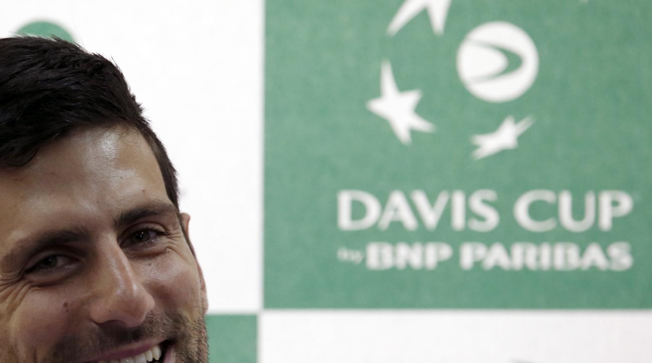 Serbian Davis Cup team player Novak Djokovic smiles during a press conference in Belgrade, Serbia, Wednesday, March 2, 2016. Serbia will play Kazakhstan in the Davis Cup World Group 1st Rrund starting on March 4-6, in Belgrade. (AP Photo/Darko Vojinovic)