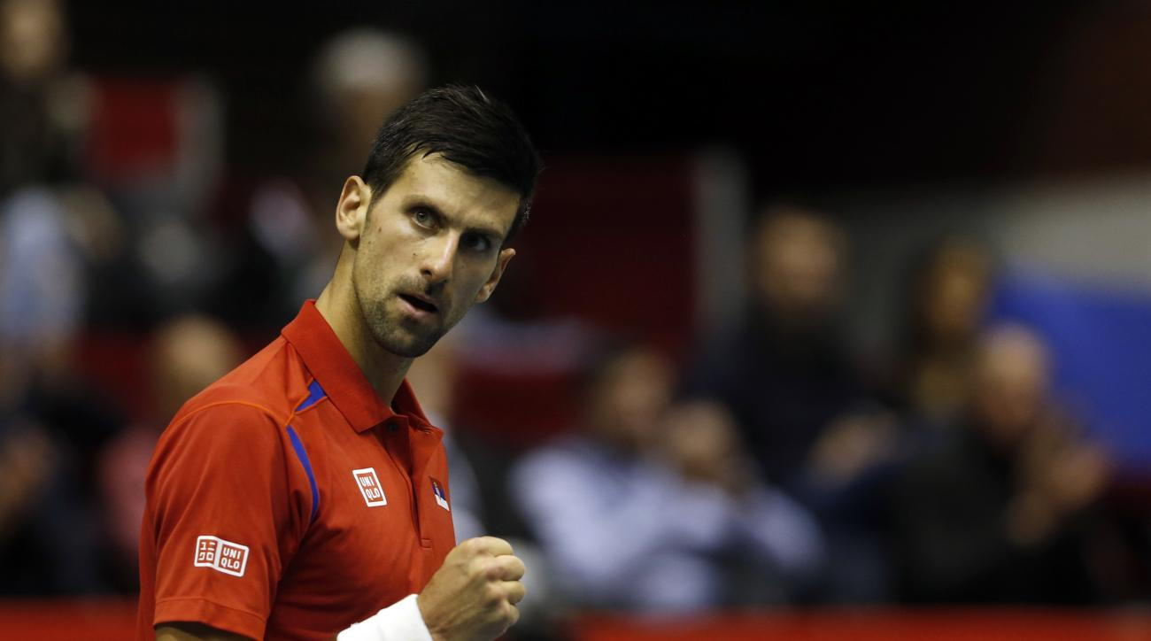 Novak Djokovic of Serbia reacts during their Davis Cup World Group first round tennis match against Kazakhstan's Aleksandr Nedovyesov, in Belgrade, Serbia, Friday, March 4, 2016. (AP Photo/Darko Vojinovic)