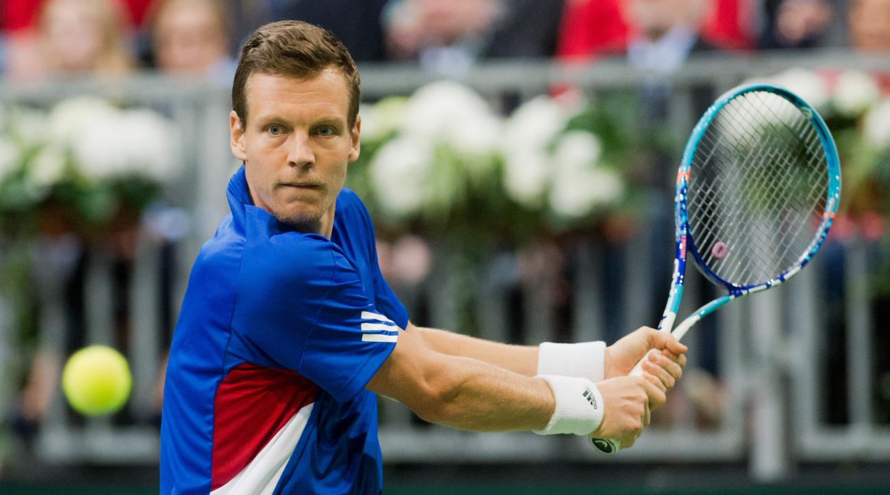 Czech Republic's Tomas Berdych  returns a ball to Germany's  Philipp Kohlschreiber during the tennis Davis Cup world Group first round match between Germany and Czech republic, in Hannover, Germany, Sunday March 6, 2016.  (Julian Stratenschulte/dpa via AP