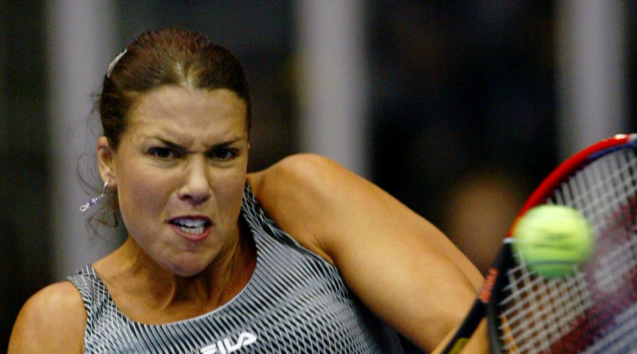 FILE - In this Nov. 5, 2004 file photo, Jennifer Capriati, of Saddlebrook, Fla., returns to Vera Zvonareva, of Russia, during their Advanta Championship quarterfinal match in Villanova, Pa. On her Twitter account Monday, March 7, 2016, Capriati said she w