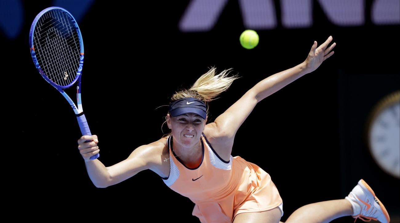 FILE -  In this Tuesday, Jan. 26, 2016, file photo, Maria Sharapova of Russia plays a forehand return to Serena Williams of the United States during their quarterfinal match at the Australian Open tennis championships in Melbourne, Australia. The five-tim