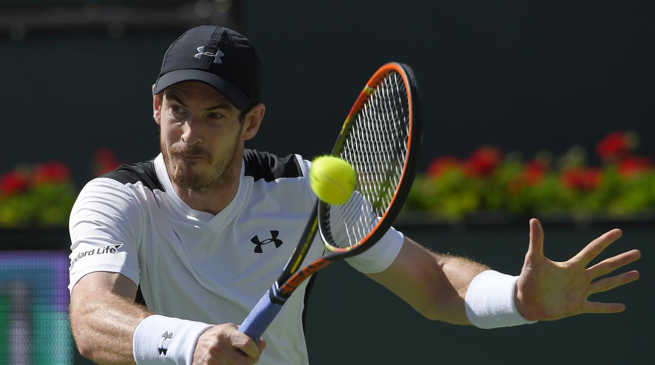 Andy Murray, of Great Britain, returns a shot from Federico Delbonis, of Argentina, during their match at the BNP Paribas Open tennis tournament, Monday, March 14, 2016, in Indian Wells, Calif. (AP Photo/Mark J. Terrill)