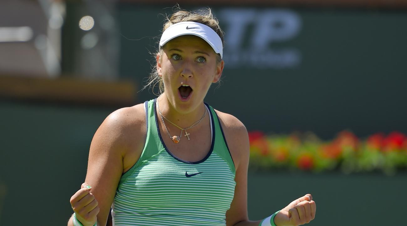Victoria Azarenka, of Belarus, reacts after defeating Serena Williams in a finals match at the BNP Paribas Open tennis tournament, Sunday, March 20, 2016, in Indian Wells, Calif. (AP Photo/Mark J. Terrill)