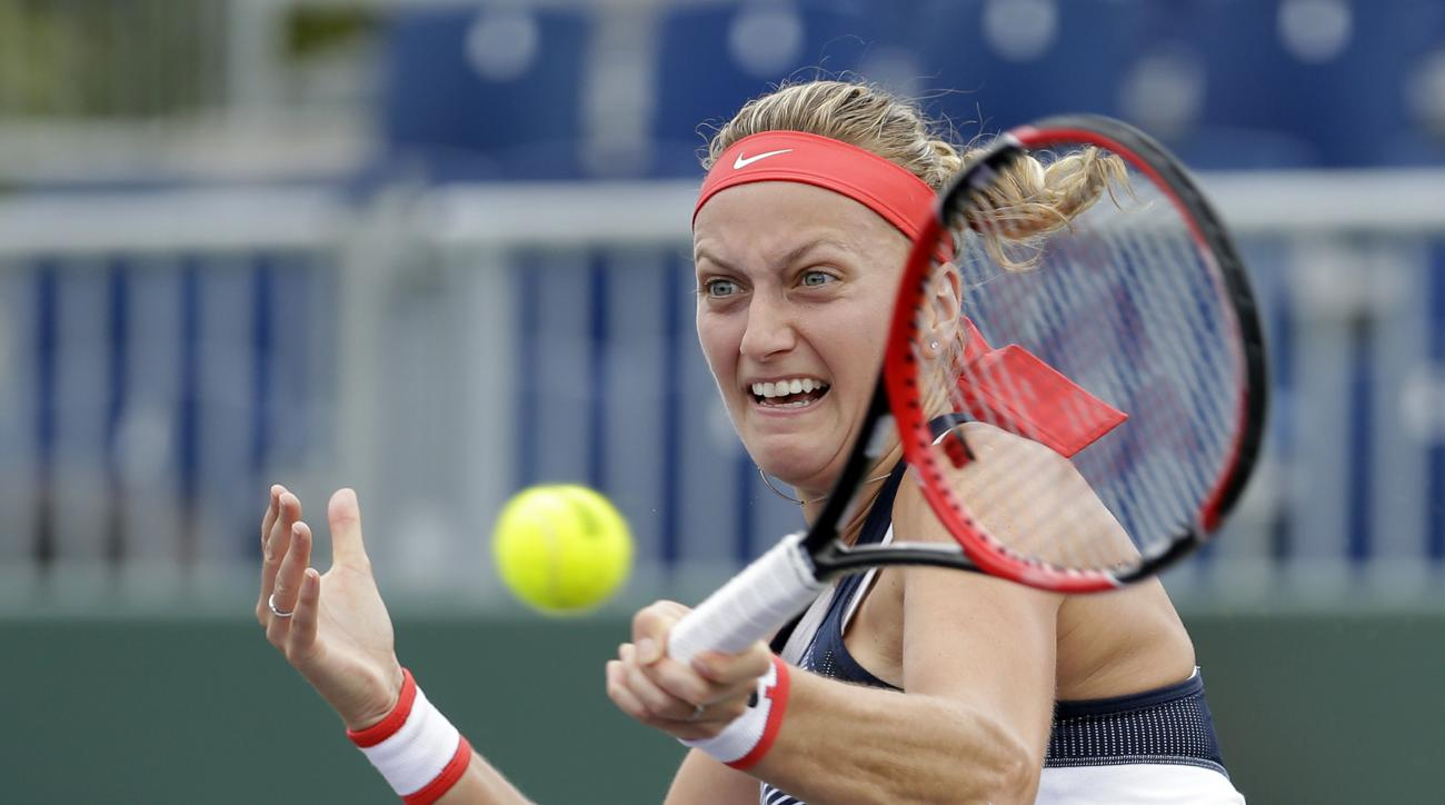 Petra Kvitova, of the Czech Republic, returns to Irina Falconi during a match at the Miami Open tennis tournament in Key Biscayne, Fla., Thursday, March 24, 2016. (AP Photo/Alan Diaz)