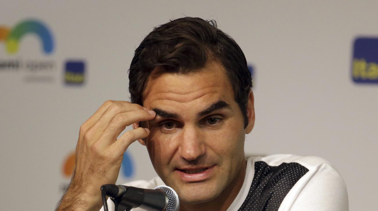 Roger Federer, of Switzerland, responds to a question during a news conference at the Miami Open tennis tournament, Thursday, March 24, 2016, in Key Biscayne, Fla. This is Federer's first tournament since having knee surgery. (AP Photo/Lynne Sladky)
