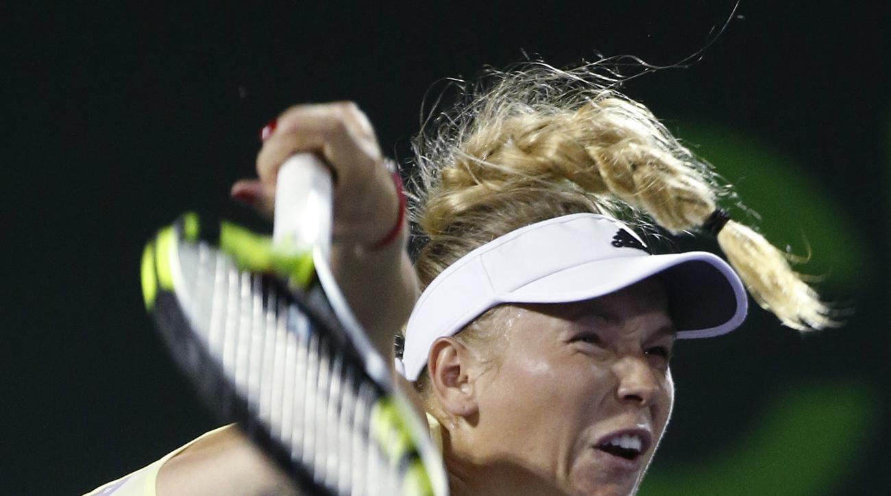 Caroline Wozniacki, of Denmark, serves to Elina Svitolina, of Ukraine, at the Miami Open tennis tournament, in Key Biscayne, Fla., Saturday, March 26, 2016. (AP Photo/Wilfredo Lee)