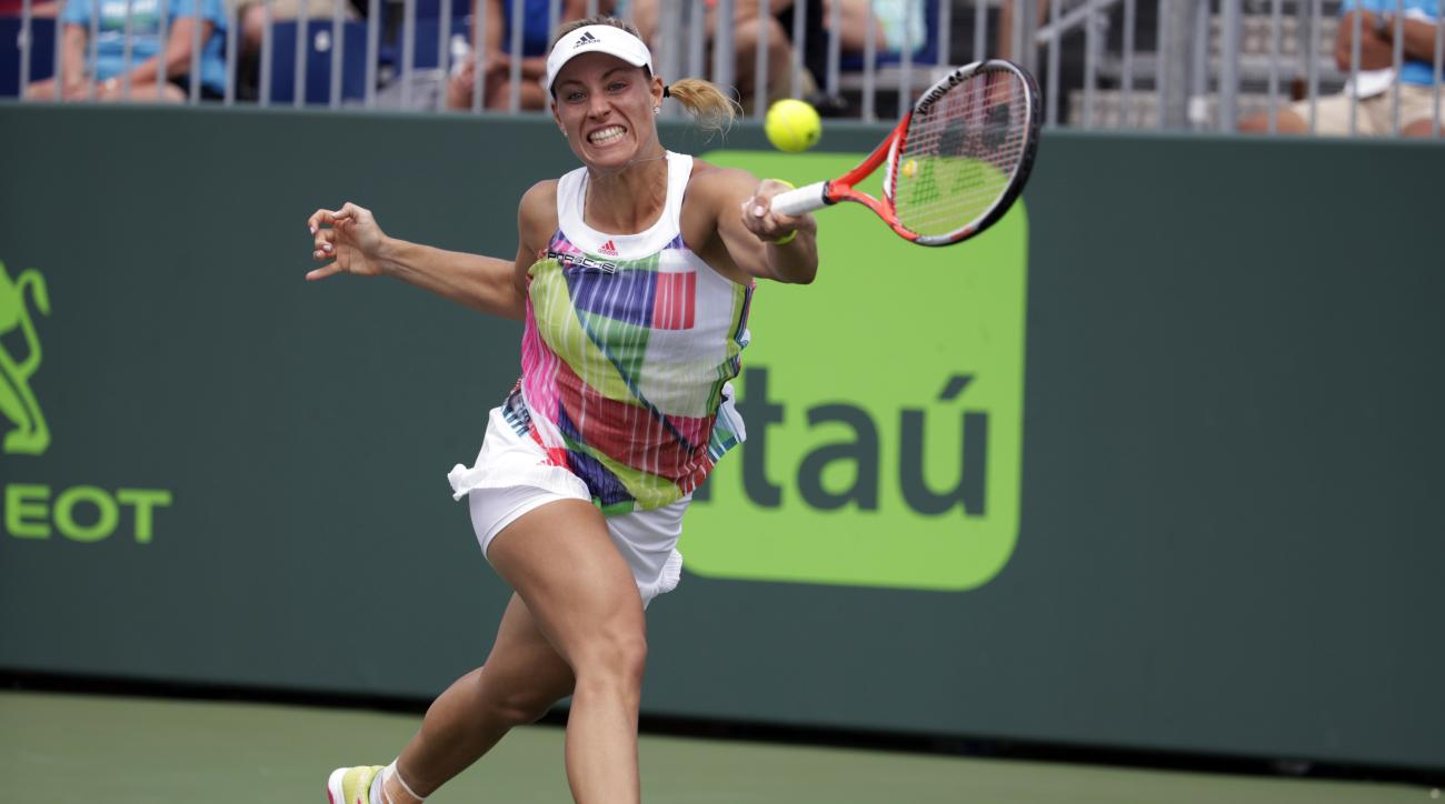 Angelique Kerber, of Germany, returns to Kiki Bertens during their match at the Miami Open tennis tournament, Sunday, March 27, 2016, in Key Biscayne, Fla. Kerber won the match after Bertens retired in the third set. (AP Photo/Lynne Sladky)