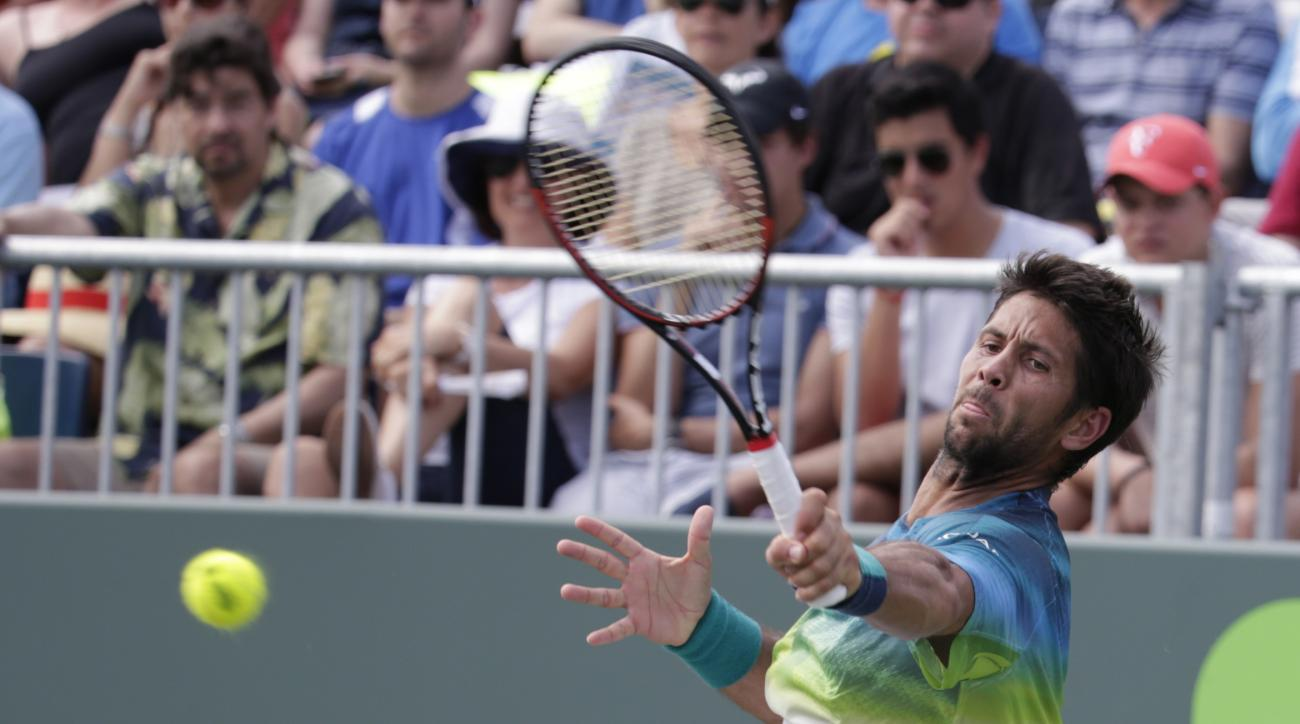 Fernando Verdasco, of Spain, returns to Horacio Zeballos during their match at the Miami Open tennis tournament, Sunday, March 27, 2016, in Key Biscayne, Fla. Zeballos won the match 1-6, 6-4, 7-6 (4). (AP Photo/Lynne Sladky)