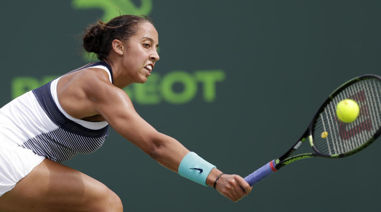 Madison Keys, of the United States, returns to Roberta Vinci, of Italy, during the Miami Open tennis tournament in Key Biscayne, Fla., Sunday, March 27, 2016. (AP Photo/Alan Diaz)
