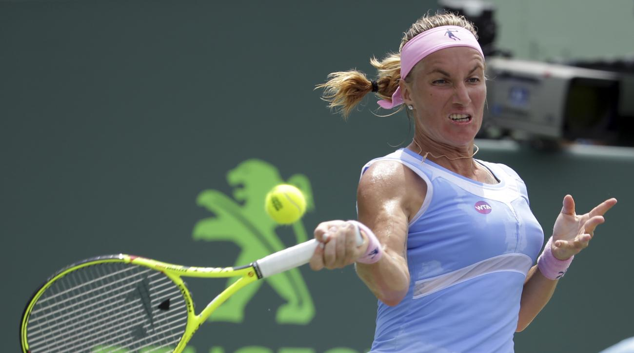 Svetlana Kuznetsova, of Russia, returns to Serena Williams during their match at the Miami Open tennis tournament, Monday, March 28, 2016, in Key Biscayne, Fla. (AP Photo/Lynne Sladky)