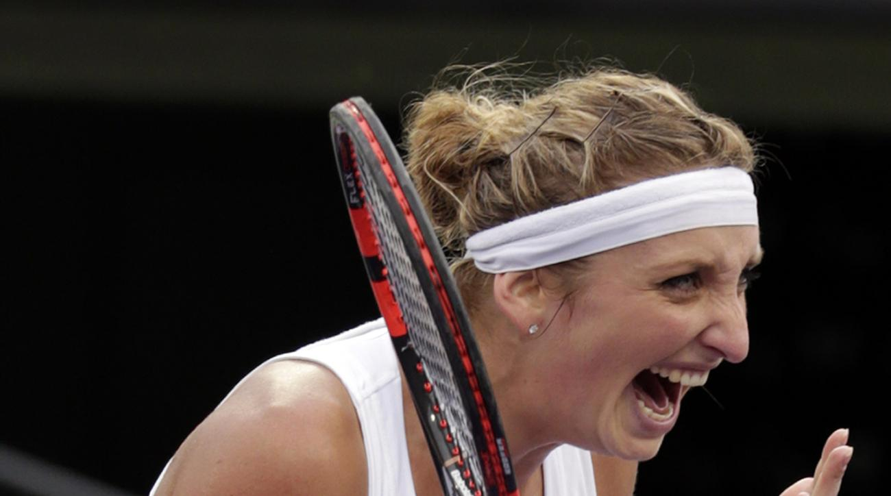 Timea Bacsinszky, of Switzerland, reacts after defeating Simona Halep at the Miami Open tennis tournament, Tuesday, March 29, 2016, in Key Biscayne, Fla. Bacsinszky won 4-6, 6-3, 6-2. (AP Photo/Lynne Sladky)
