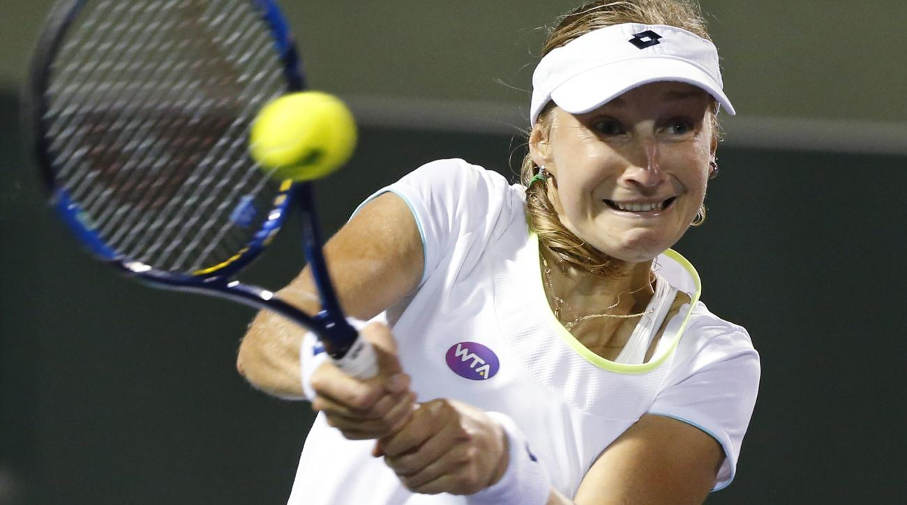 Ekaterina Makarova, of Russia, returns a shot from Svetlana Kuznetsova, also of Russia, at the Miami Open tennis tournament, Tuesday, March 29, 2016, in Key Biscayne, Fla. (AP Photo/Wilfredo Lee)