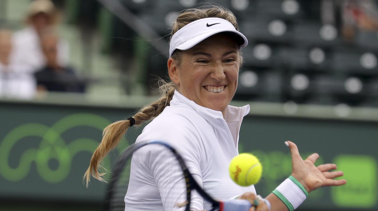 Victoria Azarenka, of Belarus, hits a return to Johanna Konta during their match at the Miami Open tennis tournament, Wednesday, March 30, 2016, in Key Biscayne, Fla. (AP Photo/Lynne Sladky)