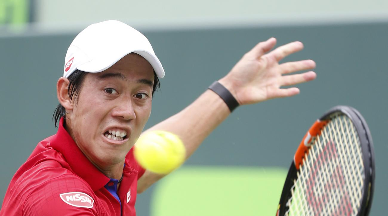 Kei Nishikori, of Japan, returns a shot from Novak Djokovic, of Serbia, during the men's singles final match at the Miami Open tennis tournament, Sunday, April 3, 2016, in Key Biscayne, Fla. Djokovic defeated Nishikori 6-3, 6-3. (AP Photo/Wilfredo Lee)