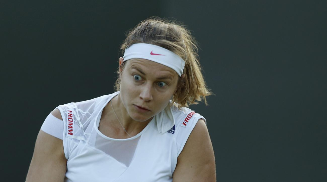 Stefanie Voegele of Switzerland returns to Madison Keys of the United States during their women's singles first round match at the All England Lawn Tennis Championships in Wimbledon, London, Tuesday June 30, 2015. (  (AP Photo/Alastair Grant)