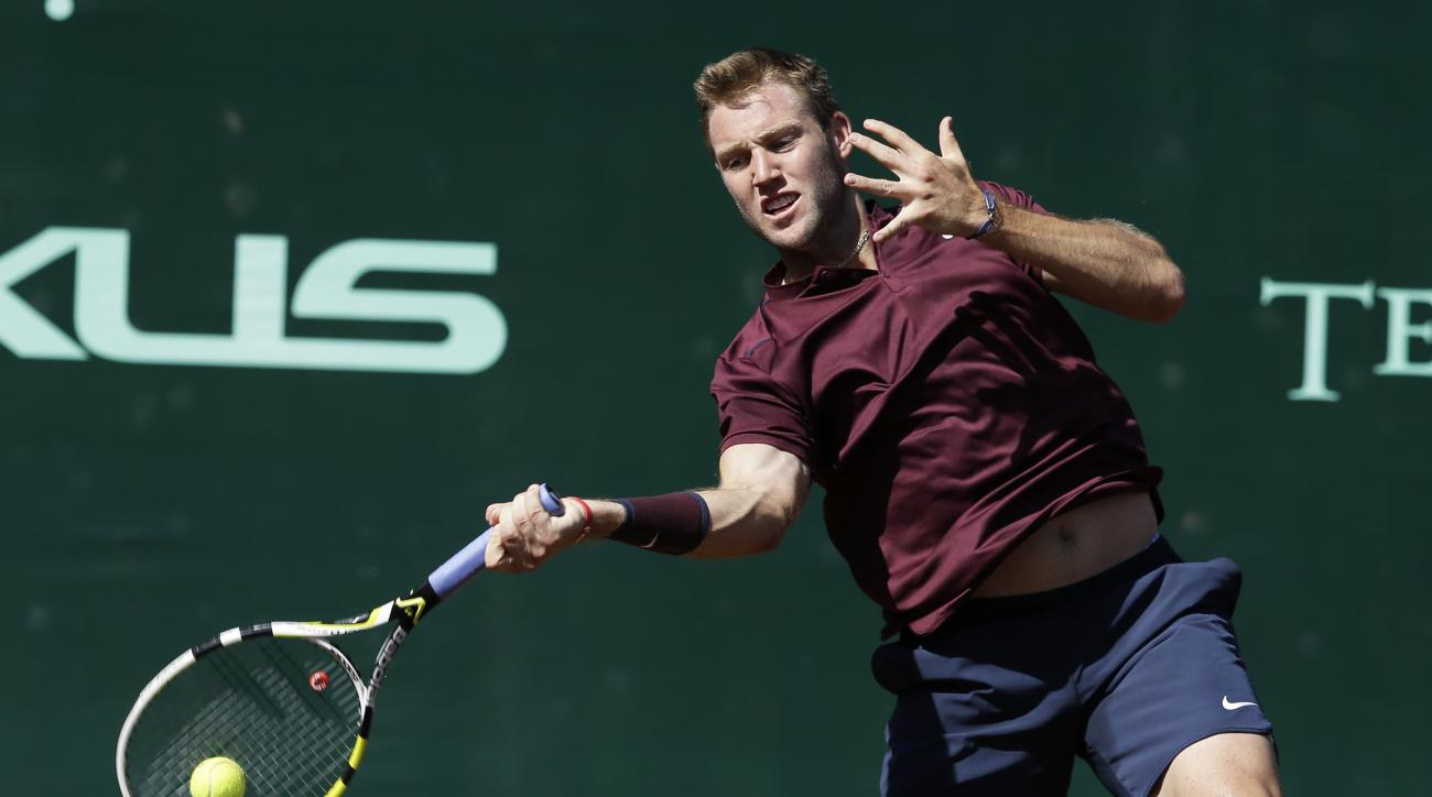 Jack Sock of the United States returns a shot to Matthew Barton of Australia at the U.S. Men's Clay Court Championship tennis tournament Thursday, April 7, 2016, in Houston. Sock won 6-2, 7-6.(AP Photo/Pat Sullivan)