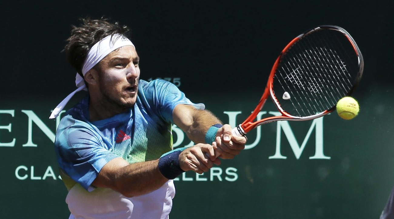 Juan Monaco of Argentina returns a shot against Sam Querrey of the United States in the quarterfinals of the U.S. men's clay court championships tennis tournament Friday, April 8, 2016, in Houston. Monaco won 6-4, 6-4. (AP Photo/Pat Sullivan)
