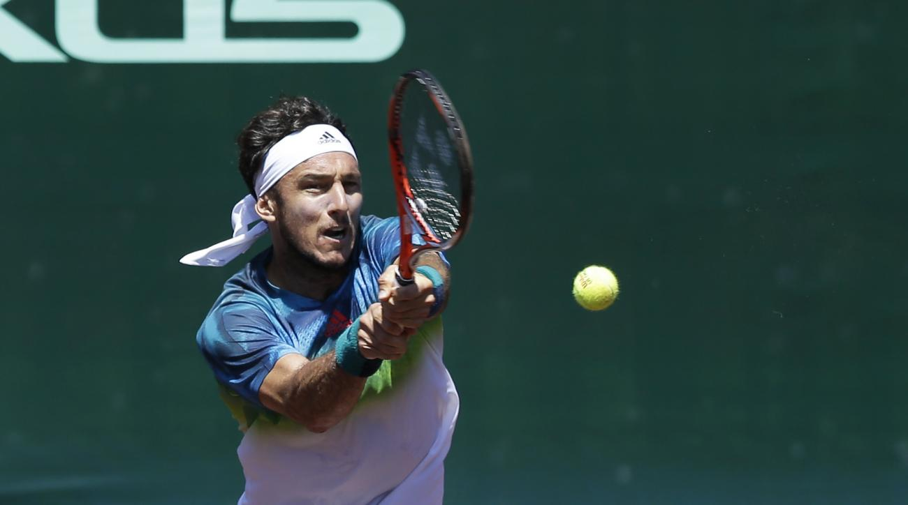 Juan Monaco, of Argentina, returns a shot against Feliciano Lopez, of Spain, in the semifinals of the U.S. Men's Clay Court Championship tennis tournament Saturday, April 9, 2016, in Houston. Monaco won 6-4, 6-2. (AP Photo/Pat Sullivan)