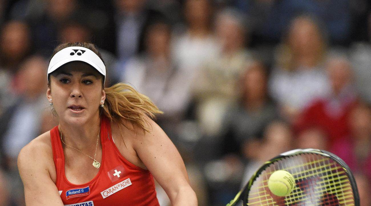 FILE - In this Feb. 7, 2016 file picture Belinda Bencic of Switzerland returns a ball to Angelique Kerber of  Germany during their Fed Cup World Group first round tennis match between Germany and Switzerland  in Leipzig, Germany. Switzerland's No. 1 Belin