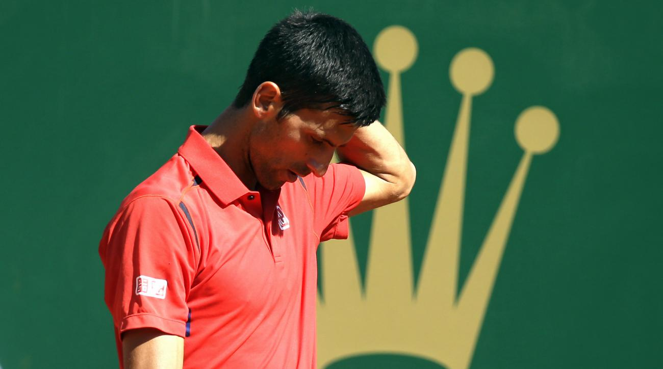 Novak Djokovic of Serbia reacts during his match of the Monte Carlo Tennis Masters tournament against Iri Vesely of Czech Republic, in Monaco, Wednesday, April 13, 2016. (AP Photo/Lionel Cironneau)