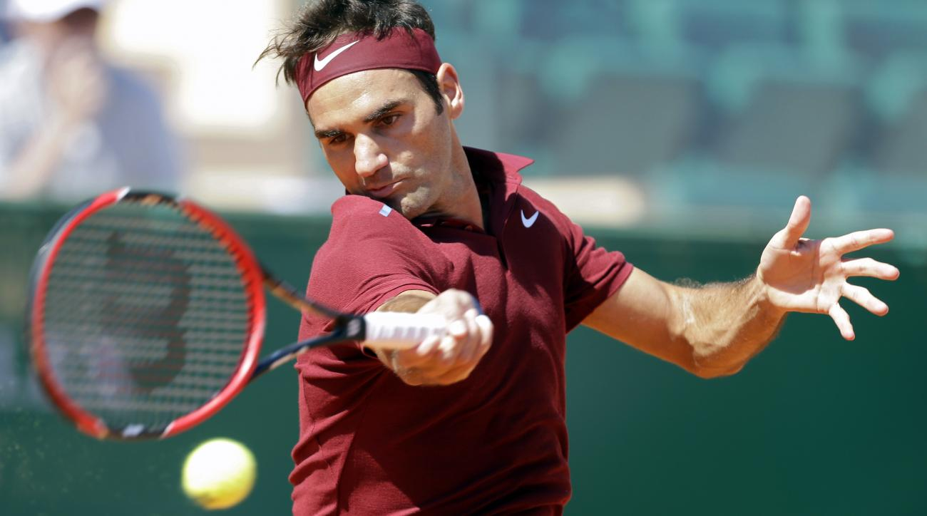 Swiss Roger Federer plays a return to France's Jo-Wilfried Tsonga during their quarter final match of the Monte Carlo Tennis Masters tournament in Monaco, Friday, April 15, 2016. (AP Photo/Lionel Cironneau)