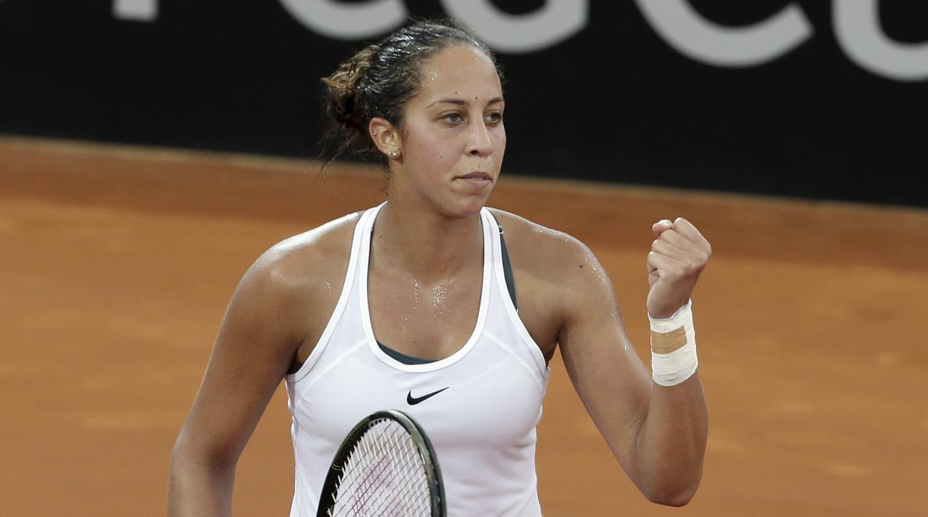 Madison Keys of the U.S. reacts after winning her match against Australia's Daria Gavrilova 6-4, 6-2, during their Fed Cup World Group play-off in Brisbane, Australia, Saturday, April 16, 2016. (AP Photo/Tertius Pickard)