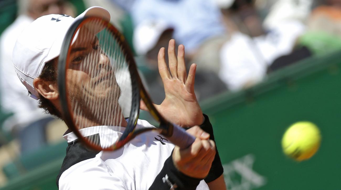 Andy Murray of Great Britain plays a return to Spain's Rafael Nadal during their semi final match of the Monte Carlo Tennis Masters tournament in Monaco, Saturday, April 16, 2016. (AP Photo/Lionel Cironneau)