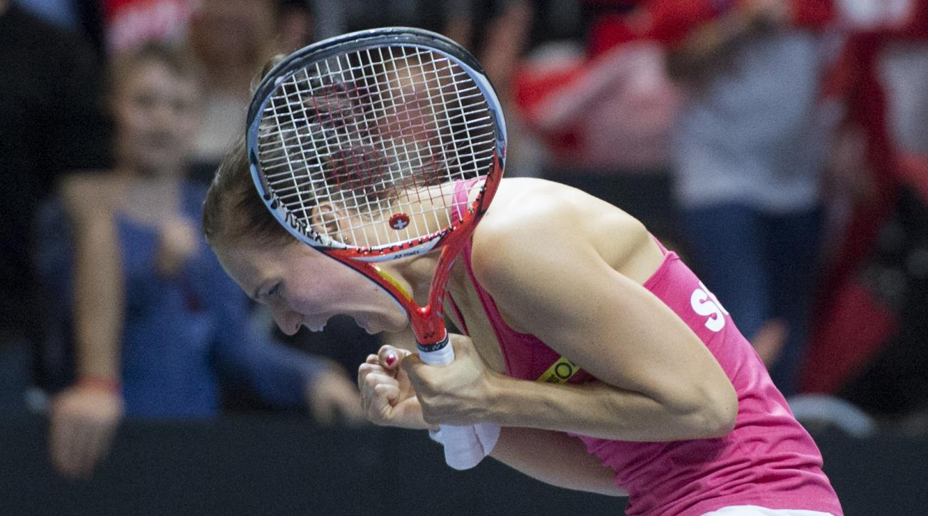 Switzerland's Viktorija Golubic reacts during her game action against Barbora Strycova of the Czech Republic,  during their Fed Cup World Group semifinal tennis match between Switzerland and the Czech Republic, in Lucerne, Switzerland, Sunday, April 17, 2