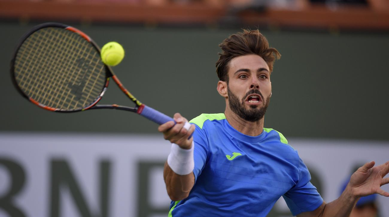 Marcel Granollers, of Spain, returns a shot from Andy Murray during their match at the BNP Paribas Open tennis tournament, Saturday, March 12, 2016, in Indian Wells, Calif. (AP Photo/Mark J. Terrill)