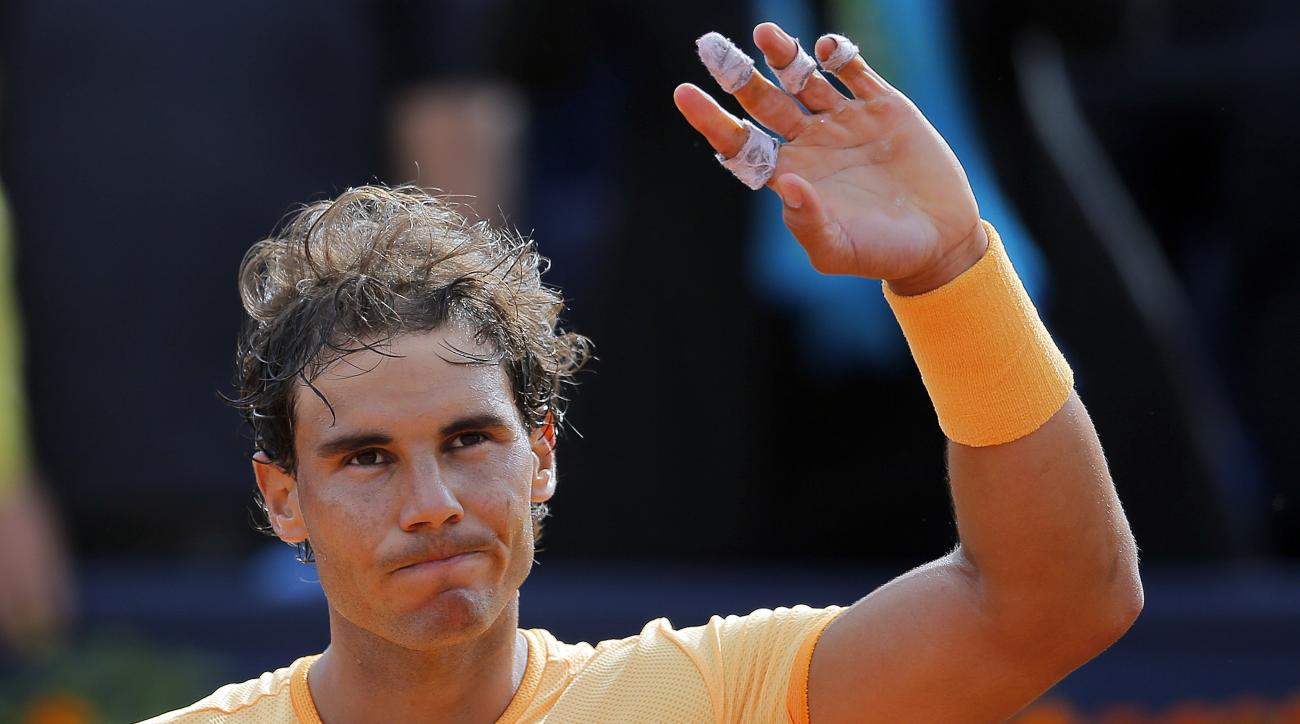 Rafael Nadal celebrates his victory over Marcel Granollers at the Barcelona open tennis tournament in Barcelona, Spain, Wednesday, April 20, 2016. (AP Photo/Manu Fernandez)