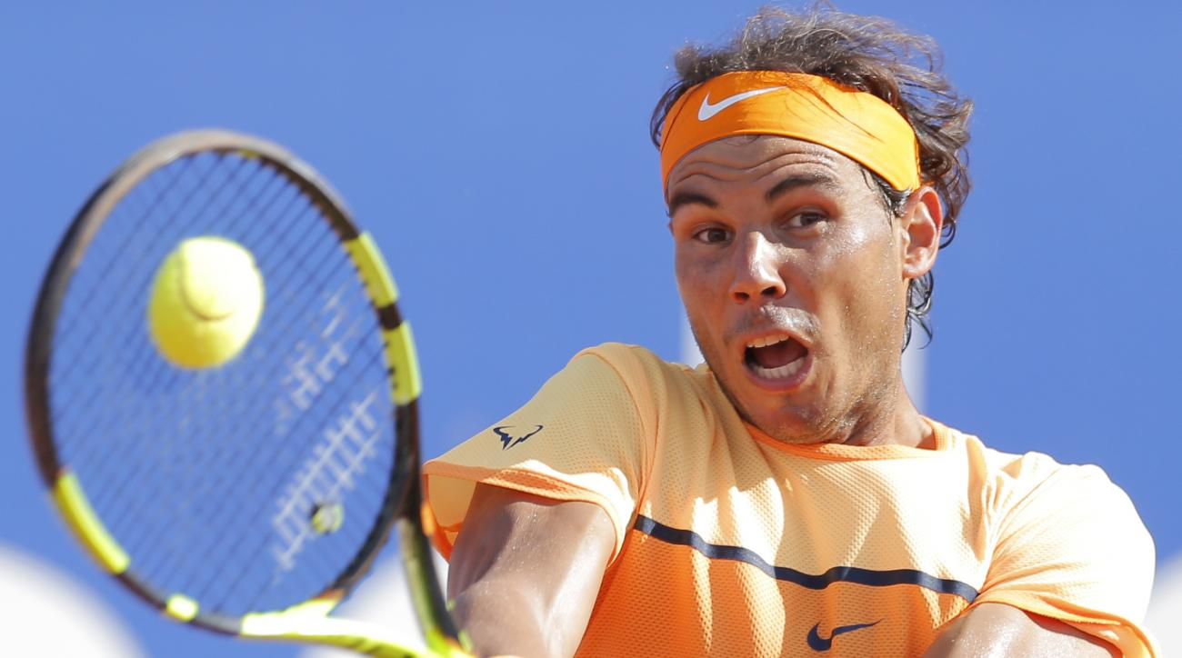 Spain's Rafael Nadal returns the ball to Philipp Kohlschreiber from Germany during the Barcelona open tennis tournament in Barcelona, Spain, Saturday, April 23, 2016. (AP Photo/Manu Fernandez)