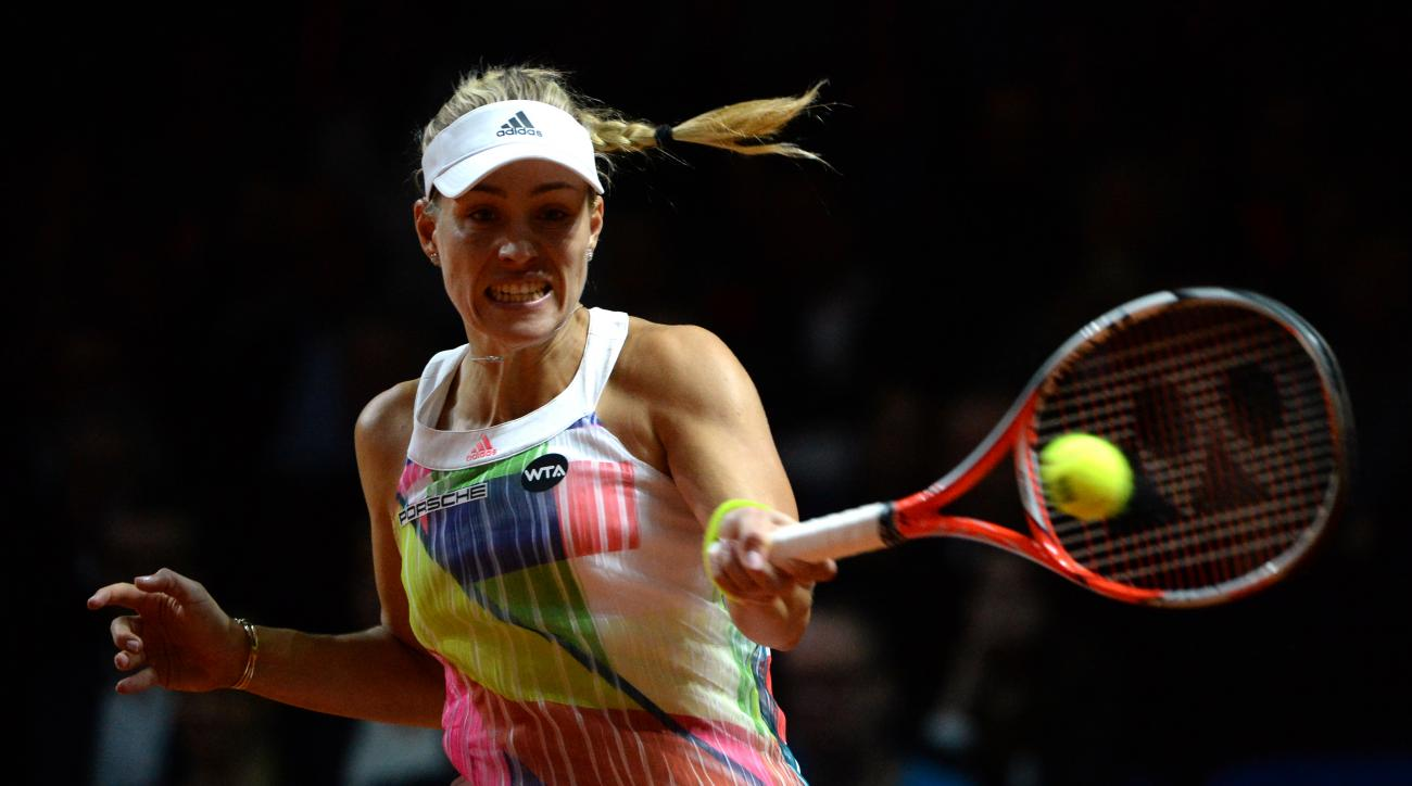 Angelique Kerber of Germany returns a ball to Laura Siegemund of Germany during the final of the WTA tennis tournament in Stuttgart, Germany, Sunday, April 24, 2016. Kerber won the match. (Marijan Murat/dpa via AP)