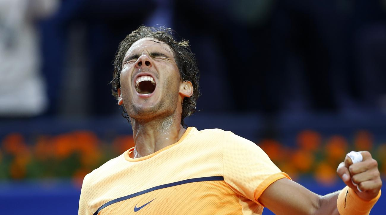 Spain's Rafael Nadal celebrates after winning the Barcelona Open tennis tournament in Barcelona, Spain, Sunday, April 24, 2016. Spain's Rafael Nadal defeated Japans Kei Nishikori 6-4 and 7-5, in the final. (AP Photo/Manu Fernandez)