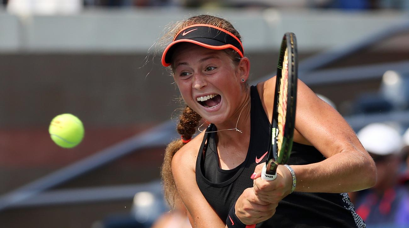 Jelena Ostapenko, of Latvia, returns a shot to Sara Errani, of Italy, during the second round of the U.S. Open tennis tournament, Thursday, Sept. 3, 2015, in New York. (AP Photo/Adam Hunger)