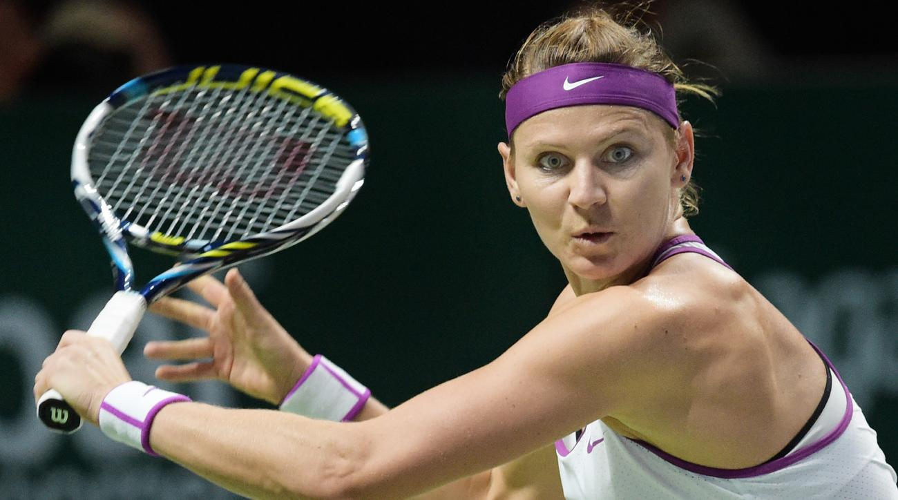 Lucie Safarova of the Czech Republic eyes the ball as she makes a backhand return against Angelique Kerber of Germany  during their singles match at the WTA tennis finals in Singapore on Friday, Oct. 30, 2015.  (AP Photo/Joseph Nair)