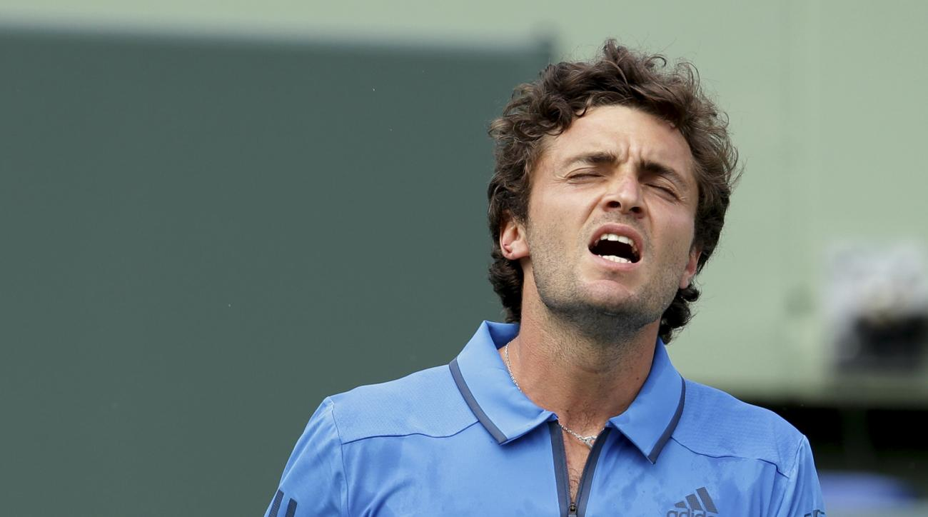 Gilles Simon, of France, reacts after missing a point against David Goffin during their match at the Miami Open tennis tournament, Wednesday, March 30, 2016, in Key Biscayne, Fla. Goffin won 3-6, 6-2, 6-1. (AP Photo/Lynne Sladky)