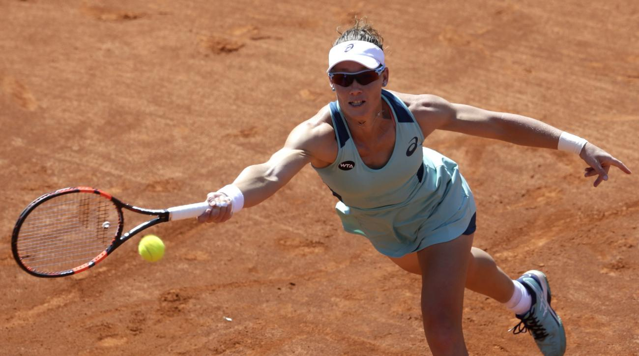 Samantha Stosur from Australia returns a ball to Czech Republic's Lucie Safarova during their final at the WTA tennis tournament in Prague, Czech Republic, Saturday, April 30, 2016. (AP Photo/Petr David Josek)