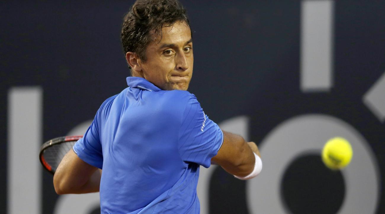 Nicolas Almagro of Spain returns the ball to Rafael Nadal of Spain, during a Rio Open tennis match, in Rio de Janeiro, Brazil, Thursday, Feb. 18, 2016. (AP Photo/Silvia Izquierdo)