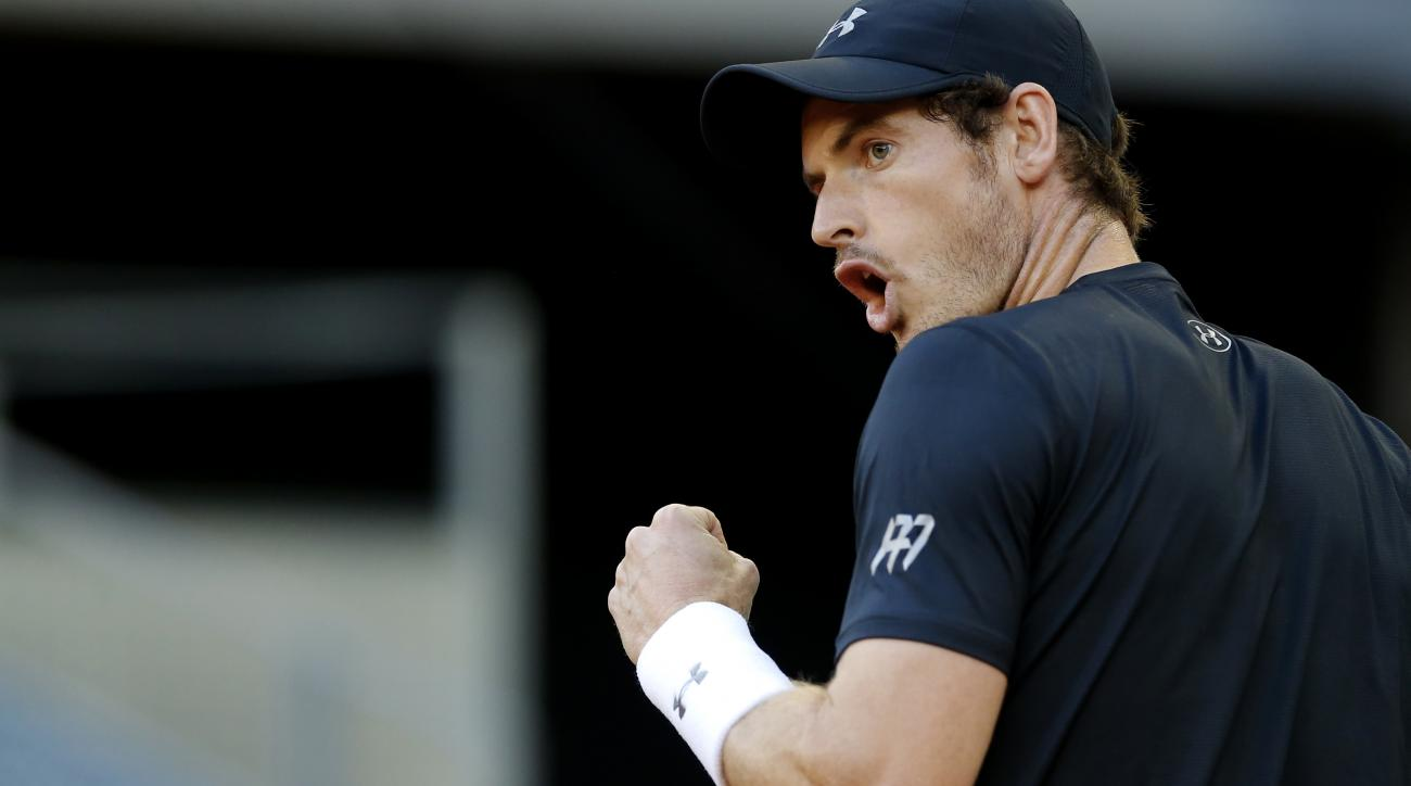 Andy Murray, from Britain, celebrates after winning a point against Radek Stepanek, from Czech Republic, during a Madrid Open tennis tournament match in Madrid, Spain, Tuesday, May 3, 2016. Murray won 7-6, 3-6 and 6-1. (AP Photo/Francisco Seco)